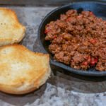 sloppy joe mix in cast iron with bun